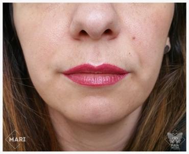 Fotografia di labbra di donna con tatuaggio semipermanente ad effetto rossetto (guarite) eseguito da Marianna bevilacqua presso lo studio Maia Tattoo di Milano Cornaredo